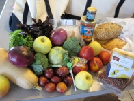 Butternut squash, apples, plums, nectarines, broccoli, basil, onion, jam, bread, lollipops, goat cheese, hamburger, kohlrabi, soap, (not pictured: devoured cheese and bacon scones, chocolate croissants)