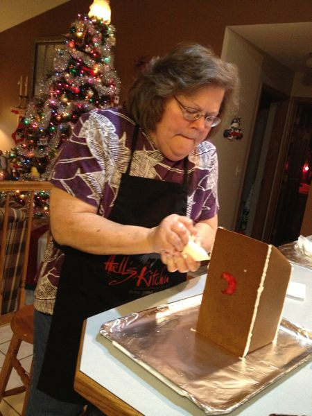 Here is my mom working on assembling her gingerbread outhouse.