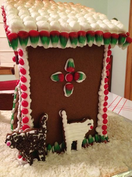 A view of the back side of the toasted outhouse, with gingerbread cats.