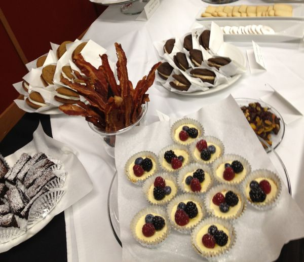 Another star of the show: chocolate-dipped bacon, mini cheesecakes, and homemade moon pies.