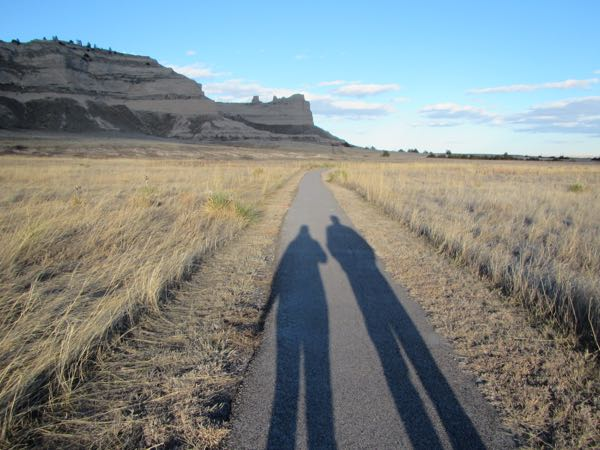 Bugman and I chased our shadows up the Saddle Rock path.