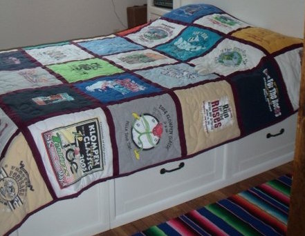 An image of our race shirt quilt, taken in our last Illinois apartment.