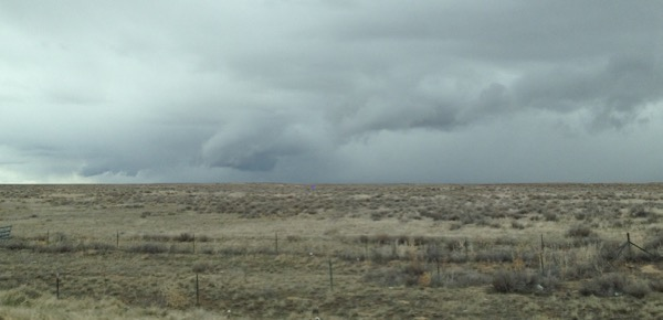 storm clouds over ranch lands